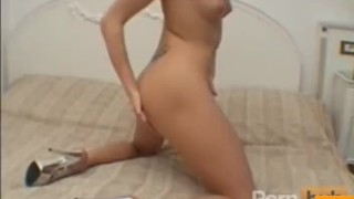 Tight blonde dildoes her twat
