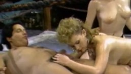 Busty oiled girls gets nailed by coach