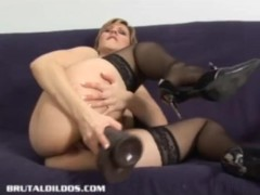 Vanessa Takes two Huge Dildos Deep In Both Holes