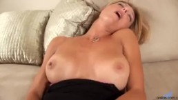 Big-tit milf prepares for dick with dong