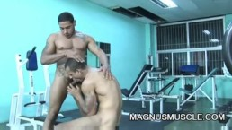 Muscle dudes teasing each other in the gym