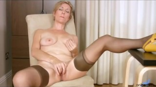 Mature office mom rubs her hairy cunt