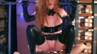 Redhead in a cop uniform sexy latex gloves and a corset fucking porno