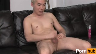 Blonde asian tugs at his cock