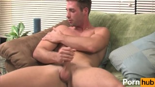 Blue-eyed hunk stroking his cock