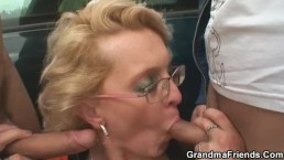 Slutty granny takes two cocks in the fields