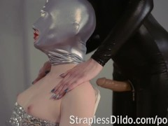 Domina in black catsuit fucks her sex doll