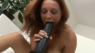 Brunette is plowed by a brutal dildo machine