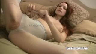 Redhead hottie Kajira fucks her glowing dildo