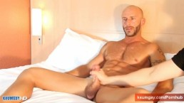 Handsome hunk guy get wanked his huge cock by us!