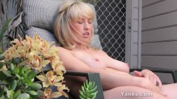 Cute blonde massage her pussy in the backyard