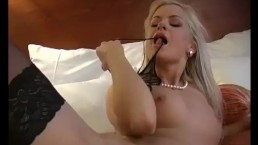 This gorgeous blonde babe moans and touches herself to orgasm