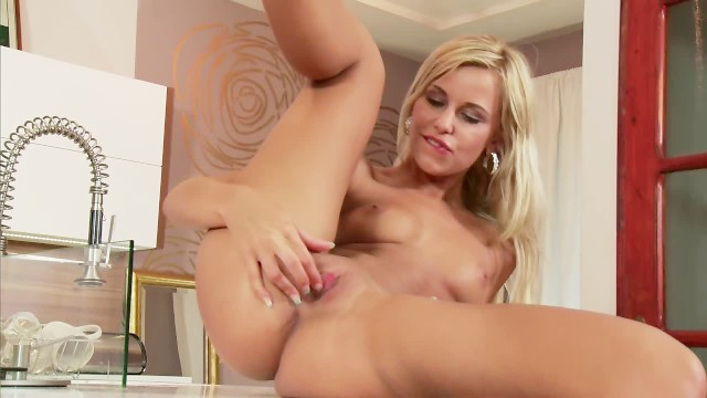 Blonde fingers her tight hole