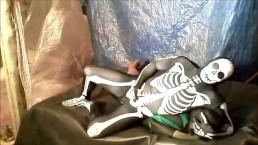 fantasy scene where spandex skeleton wrestles and humps frogman