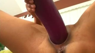 Petite Asian gapes her pussy with the mother of all big dildos