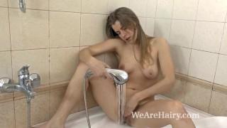 Hairy vixen Sana finds pleasure in her bathroom