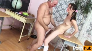 Old teacher has fun with student On first