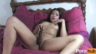 Asian babe toys with her tight pussy
