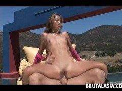 Skinny Asian babe takes a fat dick down her ass
