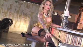 Foot fetish inked blonde gets wild with her glass dildo in stockings