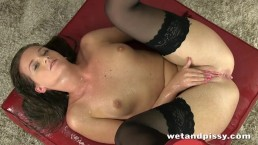 Gorgeous self pee from stocking wearing brunette