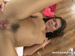 Horny brunette Tiffany Fox uses an anal butt plug while pissing in her own