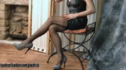 Kinky brunette milf strips off leather dress and shows her tits and thong