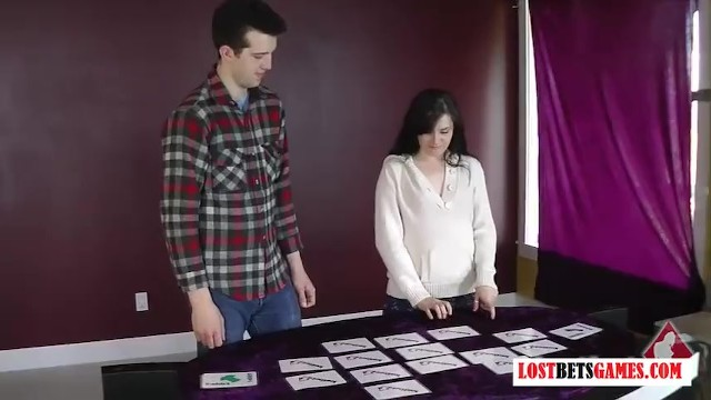 A girl and a guy play a game of strip match the cards - 2