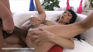 Leila gets anal gaped by Kate with a huge strapon dildo