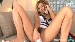 Naughty Asian girl masturbates while she talks on the phone