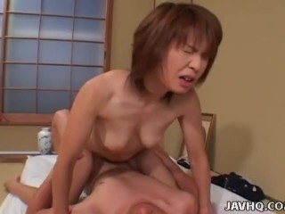 Sixty nine loving Asian cowgirl plays with a cock