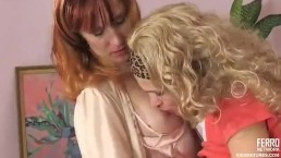 Lesbian MILF licks and kisses young girl