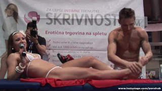 Hot massage on the erotic fair