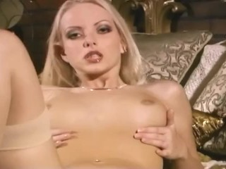 Glamour babe in thigh highs and panties strips and rubs her shaved pussy
