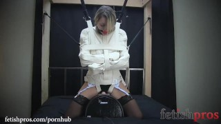 katharine kane is tied to a chair with rope bondage