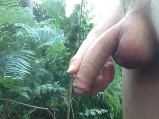 Young boy pissing in public naked