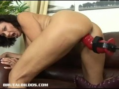 Brunette milf is fucked hard by a brutal dildo machine
