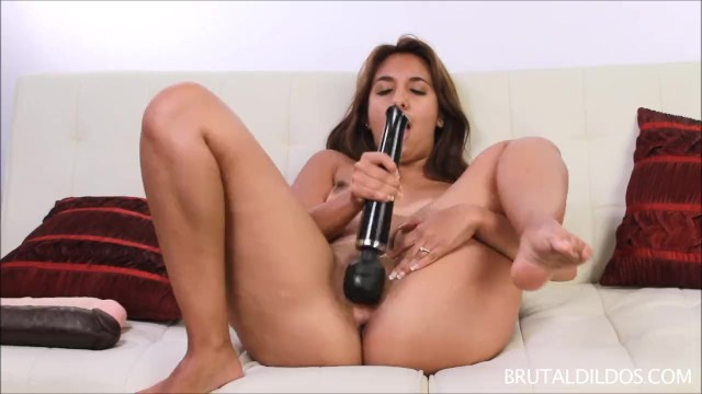 Brunette bringing her pussy to a wet orgasm with two big dildos 7