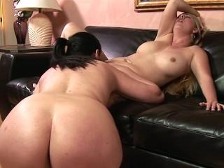 Naughty lesbian couple enjoys a good fuck with toys
