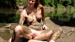 Playing in the mud out on the public river- andrea sky