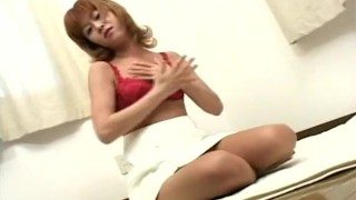 Asian seductress in red lingerie toy fucks Job outside