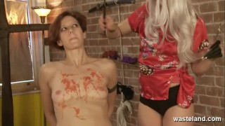 Blonde Lesbian Dominatrix covers her naked slave girl in hot wax European blowjob