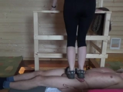 Girl in sneakers trample on cock and body