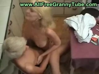Blond mom and son in the kitchen