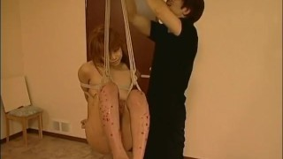 Waxed asian hanging on babe a swing gets asiansbondage bdsm