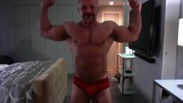 Ali Badi Posing in Red Trunks