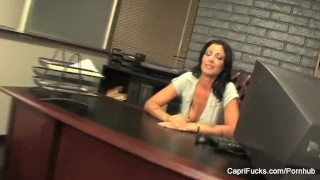 Brunettes Capri and Zoey are busty office lesbians
