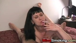 Housewife gives blowjob while smoking a cigarette porno