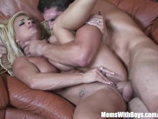 Horny blonde mom fucks a young stud...
