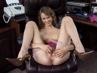 Blonde cutie Beata fucked in an office chair in nude thigh high stockings